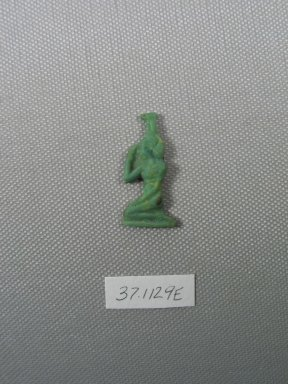 <em>Inlay in the Form of Nephthys Kneeling</em>, 343-30 B.C.E. Glass, 1 5/16 x 11/16 x 3/16 in. (3.4 x 1.7 x 0.4 cm). Brooklyn Museum, Charles Edwin Wilbour Fund, 37.1129E. Creative Commons-BY (Photo: Brooklyn Museum, CUR.37.1129E_view1.jpg)