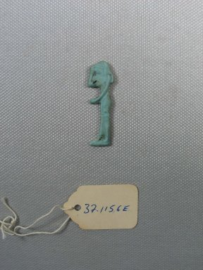<em>Inlay of a Mourning Woman, Probably Nephthys</em>, 525-30 B.C.E. Glass, 1 5/8 x 1/2 x 1/8 in. (4.1 x 1.3 x 0.3 cm). Brooklyn Museum, Charles Edwin Wilbour Fund, 37.1156E. Creative Commons-BY (Photo: Brooklyn Museum, CUR.37.1156E_view1.jpg)