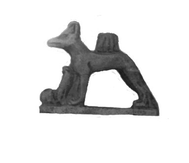 <em>Amulet Representing a Jackal and Two Uraei</em>. Stone, glazed Brooklyn Museum, Charles Edwin Wilbour Fund, 37.1189E. Creative Commons-BY (Photo: Brooklyn Museum, CUR.37.1189E_NegID_37.1121E_GRPA_cropped_bw.jpg)