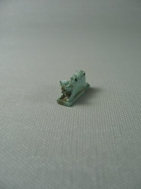 <em>Amulet Representing a Lion and a Bull Joined</em>, 664–332 B.C.E. Faience, 1/2 x 1/4 in. (1.2 x 0.6 cm). Brooklyn Museum, Charles Edwin Wilbour Fund, 37.1247E. Creative Commons-BY (Photo: Brooklyn Museum, CUR.37.1247E_View1.jpg)