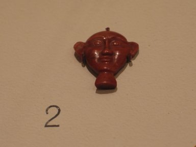 <em>Inlay in the Form of a Hieroglyph</em>, 2008-1075 B.C. Red jasper, 7/8 x 13/16 x 3/16 in. (2.2 x 2 x 0.5 cm). Brooklyn Museum, Charles Edwin Wilbour Fund, 37.1283E. Creative Commons-BY (Photo: Brooklyn Museum, CUR.37.1283E_bodyparts.jpg)
