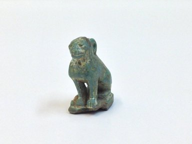 <em>Squatting Cat Amulet</em>, 664-343 B.C.E. Faience, 15/16 x 7/16 x 11/16 in. (2.4 x 1.1 x 1.7 cm). Brooklyn Museum, Charles Edwin Wilbour Fund, 37.1284E. Creative Commons-BY (Photo: Brooklyn Museum, CUR.37.1284E_view3.jpg)