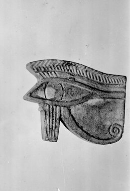 Egyptian. <em>Wadjet-eye Amulet</em>, 664-332 B.C.E. (?). Faience, 7/8 x 1 1/16 x 1/4 in. (2.3 x 2.7 x 0.6 cm). Brooklyn Museum, Charles Edwin Wilbour Fund, 37.1293E. Creative Commons-BY (Photo: Brooklyn Museum, CUR.37.1293E_bw.jpg)