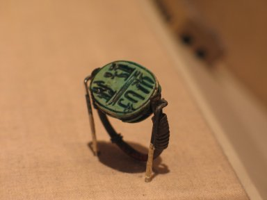 <em>Signet Ring</em>, ca. 1152-1145 B.C.E. Bronze, glazed steatite, 1 1/8 x 1 x 1/2 in. (2.9 x 2.5 x 1.3 cm). Brooklyn Museum, Charles Edwin Wilbour Fund, 37.1338E. Creative Commons-BY (Photo: Brooklyn Museum, CUR.37.1338E_wwg8.jpg)