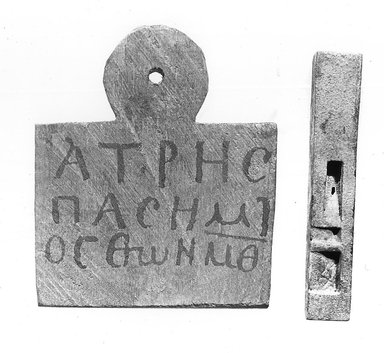 Nubian. <em>Mummy Tag of Hatres</em>, 100 C.E.-300 C.E. Wood, pigment, 3 9/16 x 3 1/8 x 7/16 in. (9.1 x 7.9 x 1.1 cm). Brooklyn Museum, Charles Edwin Wilbour Fund, 37.1392E. Creative Commons-BY (Photo: Brooklyn Museum, CUR.37.1392E_37.326E_37.326E_GrpA_print_bw.jpg)