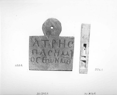 Nubian. <em>Mummy Tag of Hatres</em>, 100 C.E.-300 C.E. Wood, pigment, 3 9/16 x 3 1/8 x 7/16 in. (9.1 x 7.9 x 1.1 cm). Brooklyn Museum, Charles Edwin Wilbour Fund, 37.1392E. Creative Commons-BY (Photo: Brooklyn Museum, CUR.37.1392E_NegA_print_bw.jpg)
