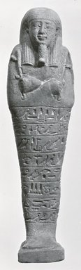 <em>Ushabti of Ptah-semem-psamtik</em>, 664-525 B.C.E. Faience, 7 13/16 x 1 15/16 x depth through base 1 9/16 in. (19.8 x 5 x 4 cm). Brooklyn Museum, Charles Edwin Wilbour Fund, 37.140E. Creative Commons-BY (Photo: Brooklyn Museum, CUR.37.140E_NegA_print_bw.jpg)