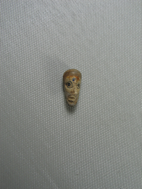 <em>Long Narrow Head Bead</em>. Glass, 7/16 x 15/16 in. (1.1 x 2.4 cm). Brooklyn Museum, Gift of Carl Wynn Browne, 37.142. Creative Commons-BY (Photo: Brooklyn Museum, CUR.37.142_view01.jpg)
