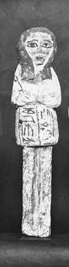 Egyptian. <em>Ushabti of Ainmose</em>, ca. 1292-656 B.C.E. Wood, pigment, 8 9/16 x 2 1/16 x 1 1/16 in. (21.8 x 5.3 x 2.7 cm). Brooklyn Museum, Charles Edwin Wilbour Fund, 37.156E. Creative Commons-BY (Photo: Brooklyn Museum, CUR.37.156E_NegGRPA_cropped_bw.jpg)