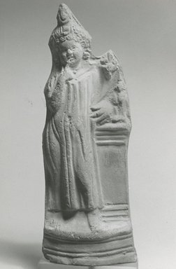 <em>Figure of Harpocrates</em>, 305-30 B.C.E., or later. Clay, pigment, 7 5/8 x 1 1/4 x 2 5/8 in. (19.3 x 3.1 x 6.6 cm). Brooklyn Museum, Charles Edwin Wilbour Fund, 37.1622E. Creative Commons-BY (Photo: Brooklyn Museum, CUR.37.1622E_NegA_print_bw.jpg)