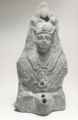 <em>Osiris on a Lamp</em>. Terracotta, pigment, 6 11/16 x 3 3/16 x 1 5/8 in. (17 x 8.1 x 4.1 cm). Brooklyn Museum, Charles Edwin Wilbour Fund, 37.1630E. Creative Commons-BY (Photo: Brooklyn Museum, CUR.37.1630E_NegB_print_bw.jpg)