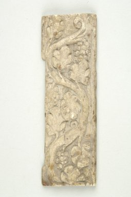 Coptic. <em>Plaque with Botanical Decoration</em>, 4th-5th century C.E. Ivory, 1 9/16 x 4 7/8 in. (4 x 12.4 cm). Brooklyn Museum, Charles Edwin Wilbour Fund, 37.1631E. Creative Commons-BY (Photo: Brooklyn Museum (in collaboration with Index of Christian Art, Princeton University), CUR.37.1631E_ICA.jpg)