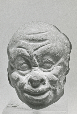<em>Male Caricature</em>, 305-30 B.C.E. Terracotta, pigment, 1 7/16 x 1 1/16 x 3 1/8 in. (3.7 x 2.7 x 7.9 cm). Brooklyn Museum, Charles Edwin Wilbour Fund, 37.1632E. Creative Commons-BY (Photo: Brooklyn Museum, CUR.37.1632E_NegB_print_bw.jpg)