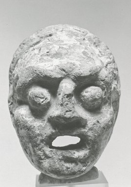 <em>Comic Mask</em>, 30 B.C.E.-395 C.E. Terracotta, pigment, 2 5/8 x 2 1/16 x 2 in. (6.7 x 5.3 x 5.2 cm). Brooklyn Museum, Charles Edwin Wilbour Fund, 37.1633E. Creative Commons-BY (Photo: Brooklyn Museum, CUR.37.1633E_NegB_print_bw.jpg)