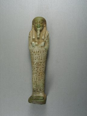 <em>Ushabti of Psamtek</em>, 664-525 B.C.E. Faience, 7 9/16 x 1 15/16 x 1 3/16 in. (19.2 x 4.9 x 3 cm). Brooklyn Museum, Charles Edwin Wilbour Fund, 37.166E. Creative Commons-BY (Photo: Brooklyn Museum, CUR.37.166E_view1.jpg)
