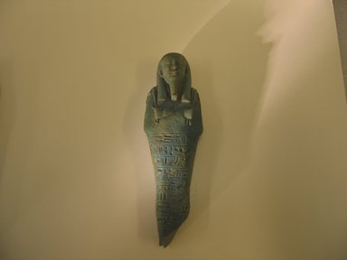 <em>Ushabti of Nefer-ib-re</em>, 664-525 B.C.E. Faience, 6 1/16 x 1 7/8 x 1 5/16 in. (15.4 x 4.7 x 3.4 cm). Brooklyn Museum, Charles Edwin Wilbour Fund, 37.167E. Creative Commons-BY (Photo: Brooklyn Museum, CUR.37.167E_view1.jpg)