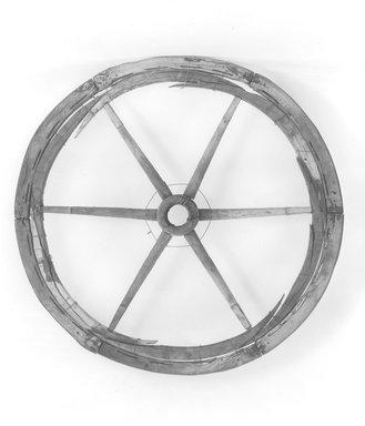 <em>Large Chariot Wheel</em>, ca. 185 B.C.E. Wood (cypress), Diam. 14 15/16 in. (38 cm). Brooklyn Museum, Charles Edwin Wilbour Fund, 37.1700E. Creative Commons-BY (Photo: Brooklyn Museum, CUR.37.1700E_NegH_print_bw.jpg)