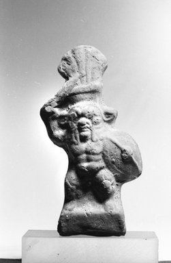 <em>Small Figure of Bes as a Warrior</em>, 30 B.C.E.-395 C.E. Terracotta, pigment, 4 5/16 x 2 3/4 x 1 in. (11 x 7 x 2.5 cm). Brooklyn Museum, Charles Edwin Wilbour Fund, 37.1712E. Creative Commons-BY (Photo: Brooklyn Museum, CUR.37.1712E_NegA_bw.jpg)