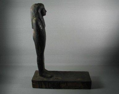 <em>Mummiform Figure</em>, ca. 1075-656 B.C.E. Wood, plaster, bitumen, linen, 14 9/16 x 3 9/16 x 10 3/8 in. (37 x 9 x 26.4 cm). Brooklyn Museum, Charles Edwin Wilbour Fund, 37.1717E. Creative Commons-BY (Photo: Brooklyn Museum, CUR.37.1717E_view8.jpg)