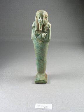 <em>Ushabti of Psamtik-men</em>, 664-332 B.C.E. Faience, 7 3/8 x 1 3/4 x 1 1/16 in. (18.7 x 4.5 x 2.7 cm). Brooklyn Museum, Charles Edwin Wilbour Fund, 37.172E. Creative Commons-BY (Photo: Brooklyn Museum, CUR.37.172E_front.jpg)