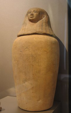 <em>Canopic Jar with Lid in the Form of a Human Head</em>, ca.1539-1353 B.C.E. Limestone, clay, pigment, Other (A): 10 1/4 x 4 5/16 in. (26.1 x 11 cm). Brooklyn Museum, Charles Edwin Wilbour Fund, 37.1733Ea-b. Creative Commons-BY (Photo: Brooklyn Museum, CUR.37.1733Ea-b_erg456.jpg)