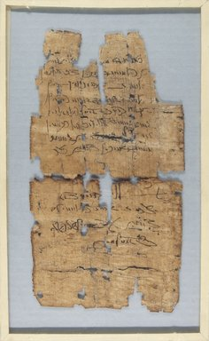 <em>Papyrus Fragments Inscribed in Demotic</em>, 1st-2nd century C.E. Papyrus, ink, Glass: 7 1/8 x 11 5/8 in. (18.1 x 29.5 cm). Brooklyn Museum, Charles Edwin Wilbour Fund, 37.1798E (Photo: , CUR.37.1797E_37.1798E_recto_IMLS_PS5.jpg)