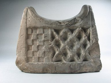 <em>Headrest</em>. Limestone, 7 3/16 × 9 1/16 × 2 13/16 in. (18.2 × 23 × 7.1 cm). Brooklyn Museum, Charles Edwin Wilbour Fund, 37.1829E. Creative Commons-BY (Photo: , CUR.37.1829E_view01.jpg)
