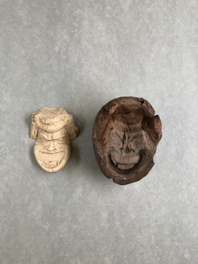 <em>Mold for Making Comic Mask</em>, 305 B.C.E.-395 C.E. Clay, 3 3/8 × 1 3/4 × 2 9/16 in. (8.6 × 4.5 × 6.5 cm). Brooklyn Museum, Charles Edwin Wilbour Fund, 37.1916E. Creative Commons-BY (Photo: , CUR.37.1916E_view01.jpg)