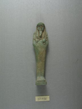 <em>Uninscribed Ushabti</em>, 664-525 B.C.E. Faience, 4 1/2 x 1 3/16 x 7/8 in. (11.5 x 3 x 2.3 cm). Brooklyn Museum, Charles Edwin Wilbour Fund, 37.193E. Creative Commons-BY (Photo: Brooklyn Museum, CUR.37.193E_view1.jpg)