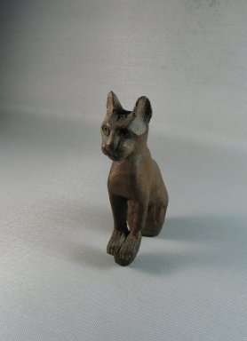 <em>Small Figure of a Cat</em>, 664-332 B.C.E. Wood, 6 1/8 x 1 3/4 x 3 3/8 in. (15.5 x 4.4 x 8.5 cm). Brooklyn Museum, Charles Edwin Wilbour Fund, 37.1949E. Creative Commons-BY (Photo: Brooklyn Museum, CUR.37.1949E_view1.jpg)