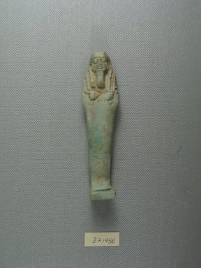 <em>Uninscribed Ushabti</em>, 664-525 B.C.E. Faience, 4 1/8 x 1 1/16 x 13/16 in. (10.5 x 2.8 x 2 cm). Brooklyn Museum, Charles Edwin Wilbour Fund, 37.195E. Creative Commons-BY (Photo: Brooklyn Museum, CUR.37.195E_view1.jpg)