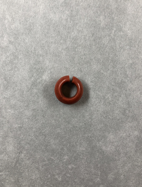 <em>Penannular Earring</em>, ca. 1539-1190 B.C.E. Red jasper, Diam. 1/4 × 9/16 in. (0.6 × 1.4 cm). Brooklyn Museum, Charles Edwin Wilbour Fund, 37.1966E. Creative Commons-BY (Photo: , CUR.37.1966E_view01.jpg)