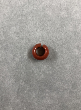 <em>Penannular Earring</em>, ca. 1539-1190 B.C.E. Red jasper, Diam. 1/4 × 1/2 in. (0.6 × 1.3 cm). Brooklyn Museum, Charles Edwin Wilbour Fund, 37.1969E. Creative Commons-BY (Photo: , CUR.37.1969E_view01.jpg)