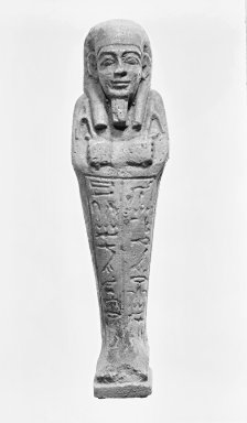 <em>Ushabti of Nesi-Kedwet</em>, 525-343 B.C.E. Faience, 4 9/16 x 1 1/4 in. (11.6 x 3.2 cm). Brooklyn Museum, Charles Edwin Wilbour Fund, 37.197E. Creative Commons-BY (Photo: Brooklyn Museum, CUR.37.197E_NegA_bw.jpg)