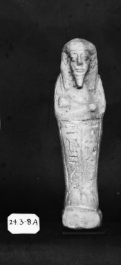 <em>Ushabti of Nesi-Kedwet</em>, 525-343 B.C.E. Faience, 4 7/16 x 1 1/4 in. (11.3 x 3.1 cm). Brooklyn Museum, Charles Edwin Wilbour Fund, 37.199E. Creative Commons-BY (Photo: Brooklyn Museum, CUR.37.199E_37.197E_NegGRPA_print_cropped_bw.jpg)