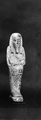 <em>Ushabti of Nesi-Kedwet</em>, 525-343 B.C.E. Faience, 4 7/16 x 1 1/4 in. (11.2 x 3.2 cm). Brooklyn Museum, Charles Edwin Wilbour Fund, 37.200E. Creative Commons-BY (Photo: Brooklyn Museum, CUR.37.200E_37.197E_NegGRPA_print_cropped_bw.jpg)