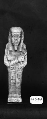 <em>Ushabti of Nesi-Kedwet</em>, 525-343 B.C.E. Faience, 4 5/16 x 1 3/8 in. (11 x 3.5 cm). Brooklyn Museum, Charles Edwin Wilbour Fund, 37.201E. Creative Commons-BY (Photo: Brooklyn Museum, CUR.37.201E_37.197E_NegGRPA_print_cropped_bw.jpg)