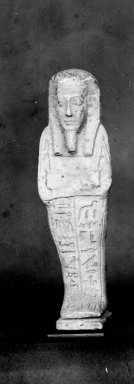 <em>Ushabti of Nesi-Kedwet</em>, 525-343 B.C.E. Faience, 4 5/16 x 1 1/4 in. (11 x 3.2 cm). Brooklyn Museum, Charles Edwin Wilbour Fund, 37.202E. Creative Commons-BY (Photo: Brooklyn Museum, CUR.37.202E_37.197E_NegGRPA_print_cropped_bw.jpg)