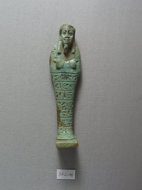 <em>Ushabti of the Chief Steward Pedi-neit</em>, 664-525 B.C.E. Faience, 5 1/8 x 1 3/8 x 13/16 in. (13 x 3.5 x 2 cm). Brooklyn Museum, Charles Edwin Wilbour Fund, 37.214E. Creative Commons-BY (Photo: Brooklyn Museum, CUR.37.214E_view1.jpg)