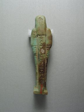 <em>Ushabti of the Chief Steward Pedi-neit</em>, 664-525 B.C.E. Faience, 5 1/8 x 1 3/8 x 13/16 in. (13 x 3.5 x 2 cm). Brooklyn Museum, Charles Edwin Wilbour Fund, 37.214E. Creative Commons-BY (Photo: Brooklyn Museum, CUR.37.214E_view4.jpg)