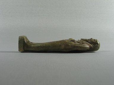 <em>Mummiform Ushabti of Wah-ib-re-em-akhet</em>, 664-525 B.C.E. Faience, 4 3/4 x 1 3/8 x 7/8 in. (12 x 3.5 x 2.3 cm). Brooklyn Museum, Charles Edwin Wilbour Fund, 37.216E. Creative Commons-BY (Photo: Brooklyn Museum, CUR.37.216E_view2.jpg)