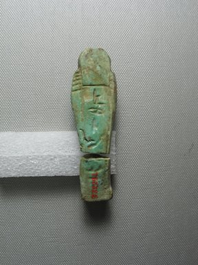 <em>Ushabti of Yuf-o</em>, 664-343 B.C.E. Faience, 3 9/16 x 1 1/16 x 11/16 in. (9 x 2.8 x 1.8 cm). Brooklyn Museum, Charles Edwin Wilbour Fund, 37.229E. Creative Commons-BY (Photo: Brooklyn Museum, CUR.37.229E_view5.jpg)