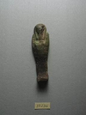 <em>Ushabti of Yuf-o</em>, 664-343 B.C.E. Faience, 3 9/16 x 7/8 x 13/16 in. (9 x 2.3 x 2 cm). Brooklyn Museum, Charles Edwin Wilbour Fund, 37.231E. Creative Commons-BY (Photo: Brooklyn Museum, CUR.37.231E_view1.jpg)