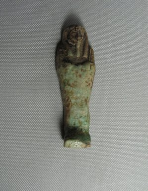 <em>Ushabti of Yuf-o</em>, 664-343 B.C.E. Faience, 3 9/16 x 7/8 x 1/2 in. (9 x 2.3 x 1.3 cm). Brooklyn Museum, Charles Edwin Wilbour Fund, 37.232E. Creative Commons-BY (Photo: Brooklyn Museum, CUR.37.232E_view2.jpg)