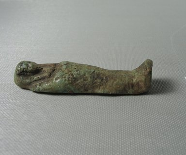 <em>Ushabti of Yuf-o</em>, 664-343 B.C.E. Faience, 3 1/4 x 7/8 x 1/2 in. (8.3 x 2.3 x 1.3 cm). Brooklyn Museum, Charles Edwin Wilbour Fund, 37.233E. Creative Commons-BY (Photo: Brooklyn Museum, CUR.37.233E_view5.jpg)