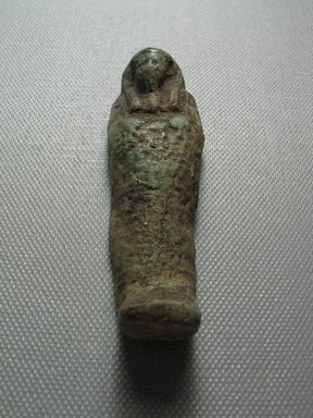 <em>Ushabti of Yuf-o</em>, 664-343 B.C.E. Faience, 3 1/4 x 7/8 x 1/2 in. (8.3 x 2.3 x 1.3 cm). Brooklyn Museum, Charles Edwin Wilbour Fund, 37.233E. Creative Commons-BY (Photo: Brooklyn Museum, CUR.37.233E_view9.jpg)