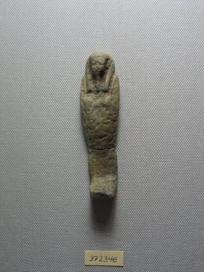 <em>Ushabti of Yuf-o</em>, 664-343 B.C.E. Faience, 3 9/16 x 7/8 x 1/2 in. (9 x 2.3 x 1.3 cm). Brooklyn Museum, Charles Edwin Wilbour Fund, 37.234E. Creative Commons-BY (Photo: Brooklyn Museum, CUR.37.234E_view2.jpg)