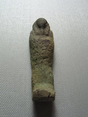 <em>Ushabti of Yuf-o</em>, 664-343 B.C.E. Faience, 3 9/16 x 7/8 x 1/2 in. (9 x 2.3 x 1.3 cm). Brooklyn Museum, Charles Edwin Wilbour Fund, 37.235E. Creative Commons-BY (Photo: Brooklyn Museum, CUR.37.235E_view5.jpg)