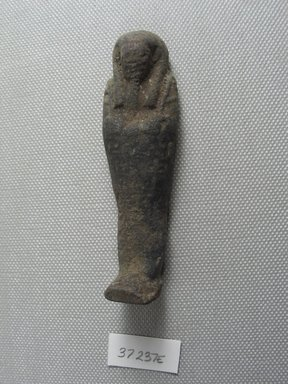 <em>Ushabti of Yuf-o</em>, 664-343 B.C.E. Faience, 3 1/4 x 1 x 13/16 in. (8.3 x 2.5 x 2 cm). Brooklyn Museum, Charles Edwin Wilbour Fund, 37.237E. Creative Commons-BY (Photo: Brooklyn Museum, CUR.37.237E_view4.jpg)
