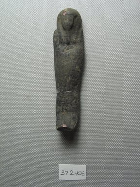 <em>Ushabti of Yuf-o</em>, 664-343 B.C.E. Faience, 3 9/16 x 7/8 x 9/16 in. (9 x 2.3 x 1.5 cm). Brooklyn Museum, Charles Edwin Wilbour Fund, 37.240E. Creative Commons-BY (Photo: Brooklyn Museum, CUR.37.240E_view3.jpg)